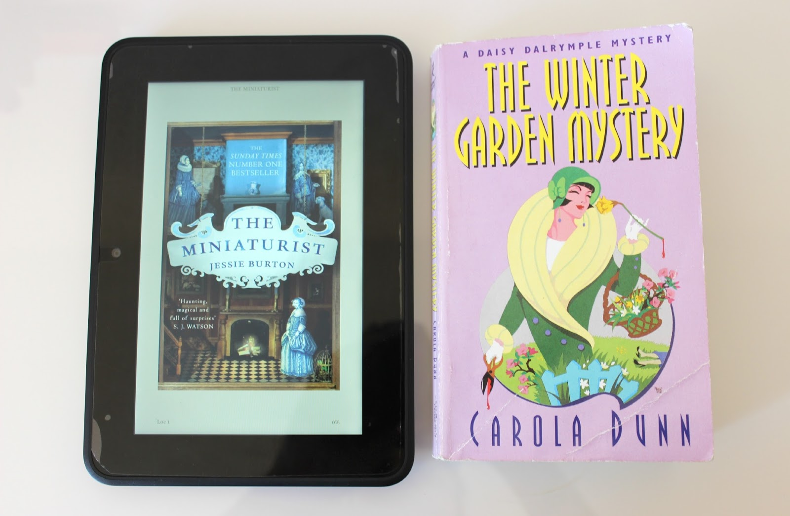A picture of The Miniaturist by Jessie Burton and The Winter Garden Mystery by Carola Dunn