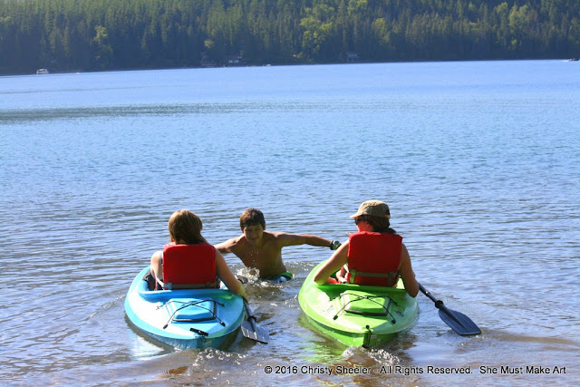My children and I spend time on the lake with the kayaks.