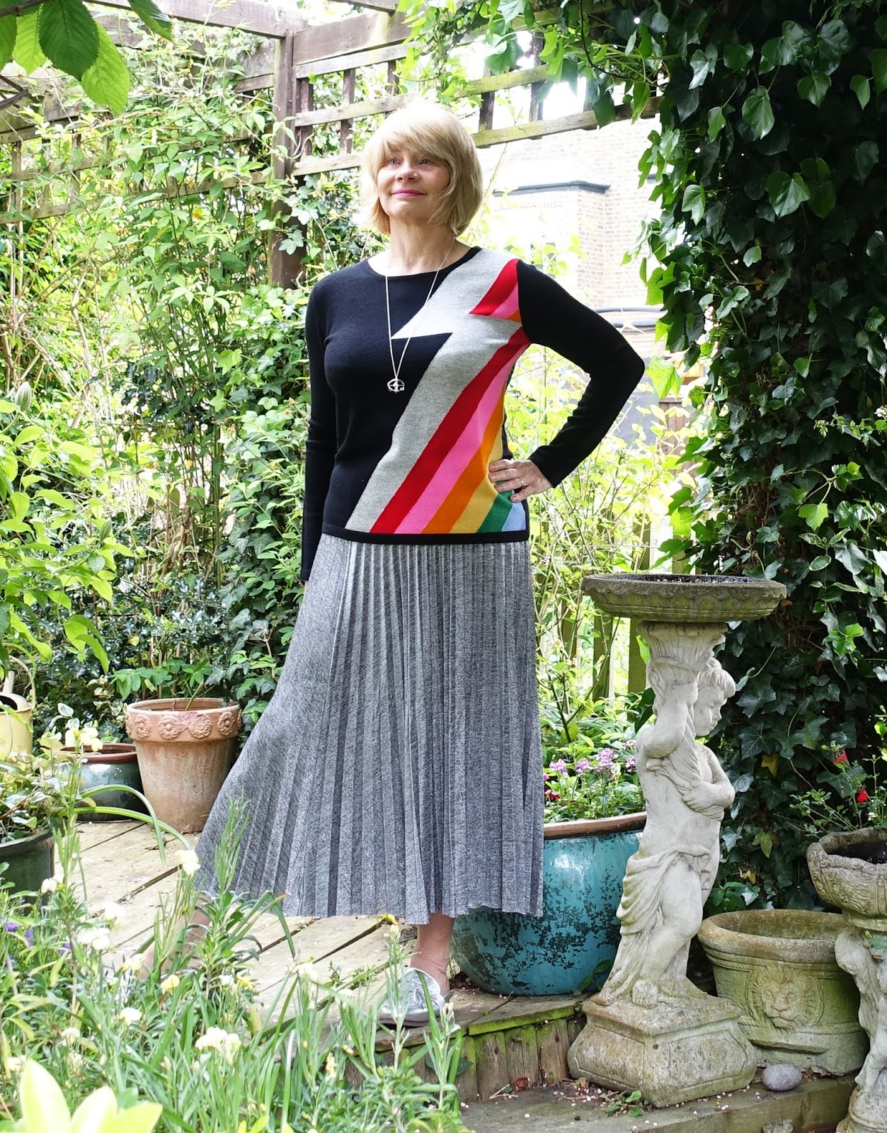 Showing your stripes: woman in black cashmere jumper with rainbow Bowie stripe