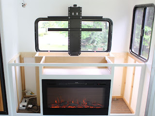 Mountain Modern Life used a Touchstone TV Lift and Sideline26 Electric Fireplace for a RV renovation.