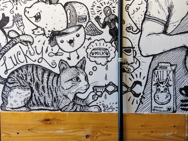 Artwork on the walls at Tolido Espresso Nook in Kampong Glam neighborhood of Singapore