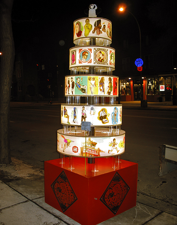 A Christmas Tree in forms of Chinese Lantern designed by Ben Liu, artist and fashion illustrator in Montreal exhibition on Pleateau Mont-Royal, Ben wearing panda BENDA hat with smiley face