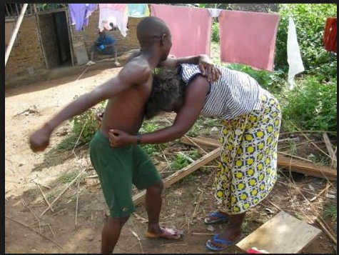 Image result for pictures of Nigerian man and wife fighting