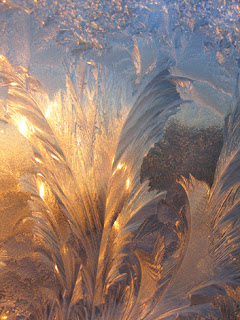 Photo of a Frosted Window With Light Shining Through