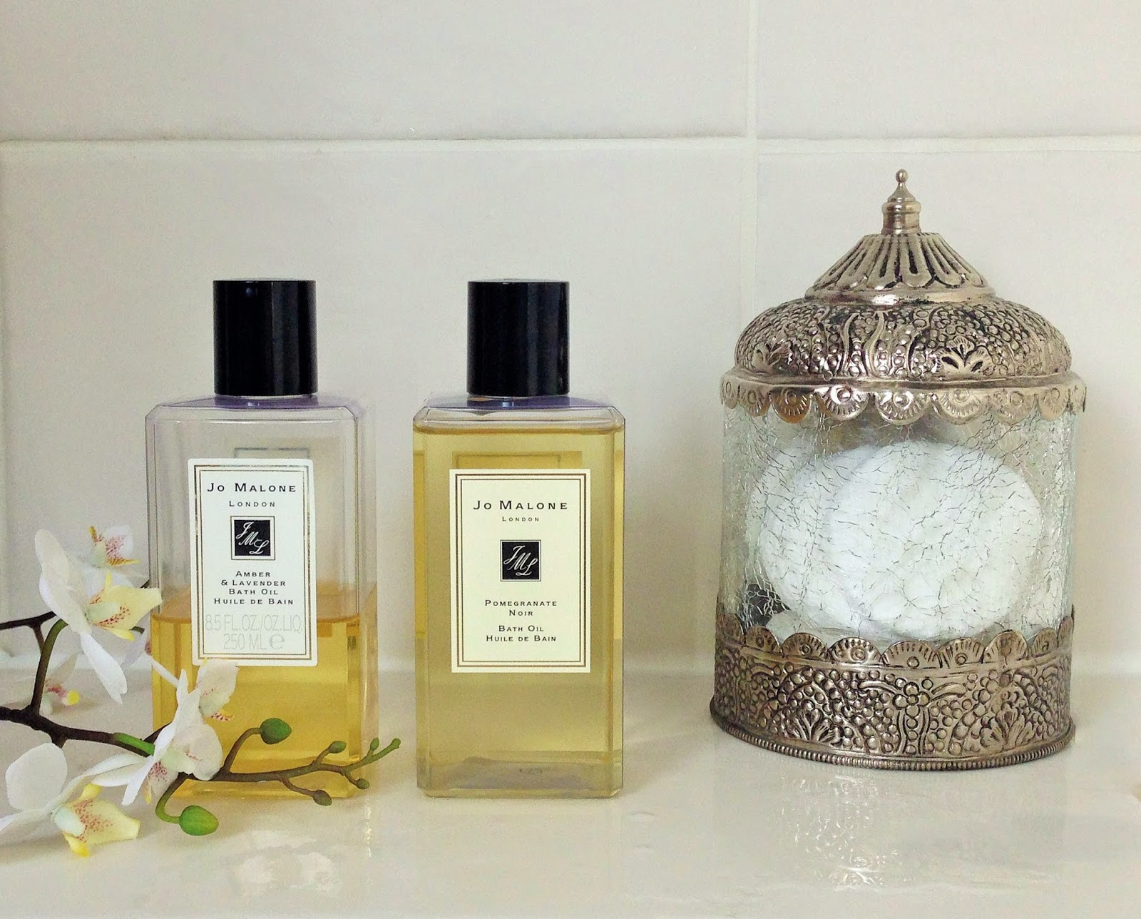 Jo Malone bath oils in Amber and Lavender and Pomegranate Noir