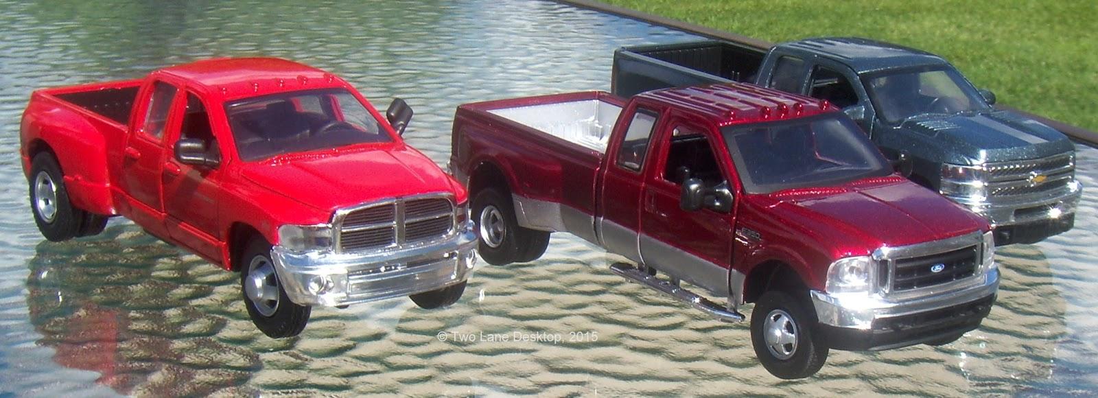 comparison new ray 1 32 chevy silverado 2500hd dodge ram 3500 and ford f 350 super duty [ 1600 x 580 Pixel ]