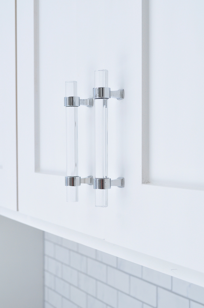 Lucite cabinet and drawer pulls in a white shaker kitchen. So affordable- about $3 each! | via monicawantsit.com