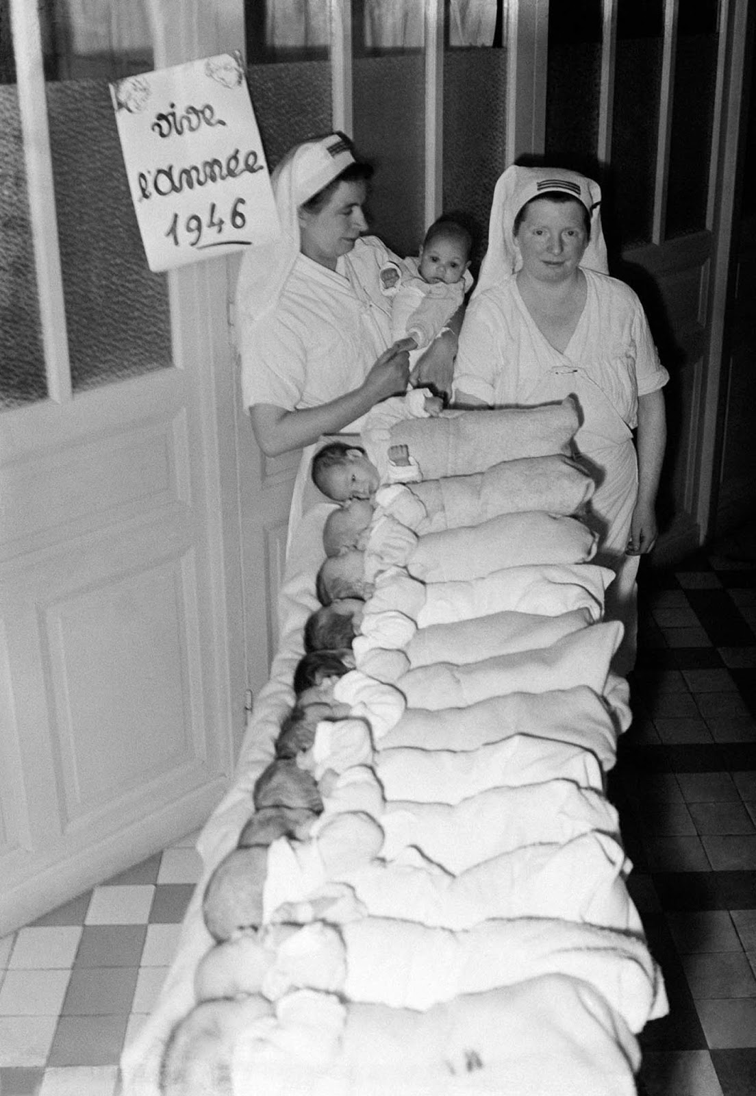 The first babies of the new year in a maternity ward in Paris, 1946.