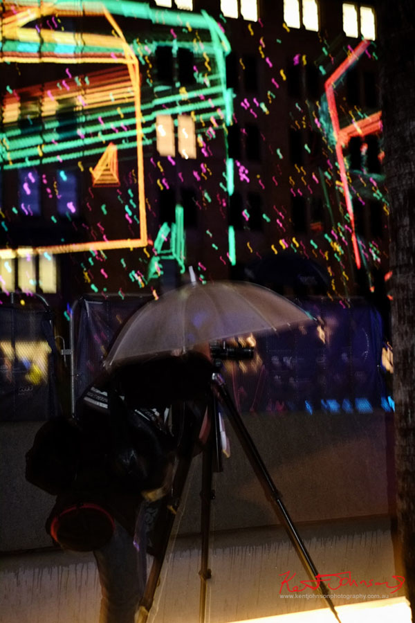 Man photographing the Vivid light projections at Circular Quay 2013.