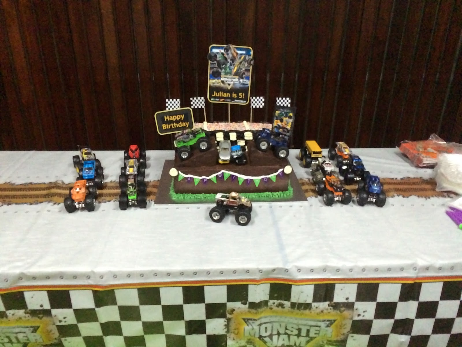 ... birthday party! Check out the cake with the army of Monster Trucks