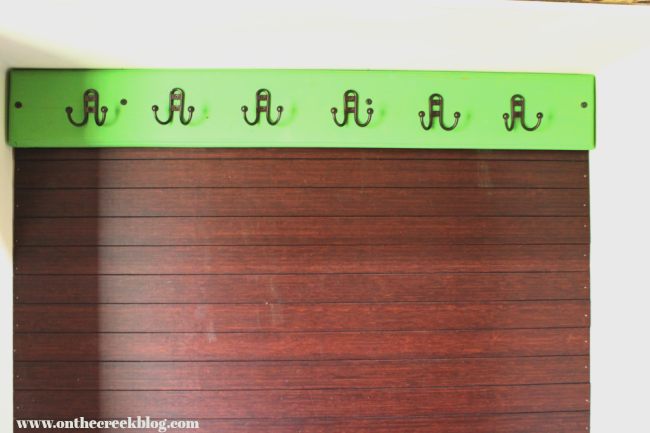 Painted salvaged wood coat rack using Antibes Green Annie Sloan Chalk Paint®