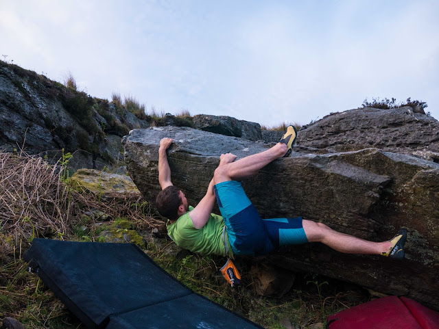Turquoise bouldering shorts in use at Craigmaddie