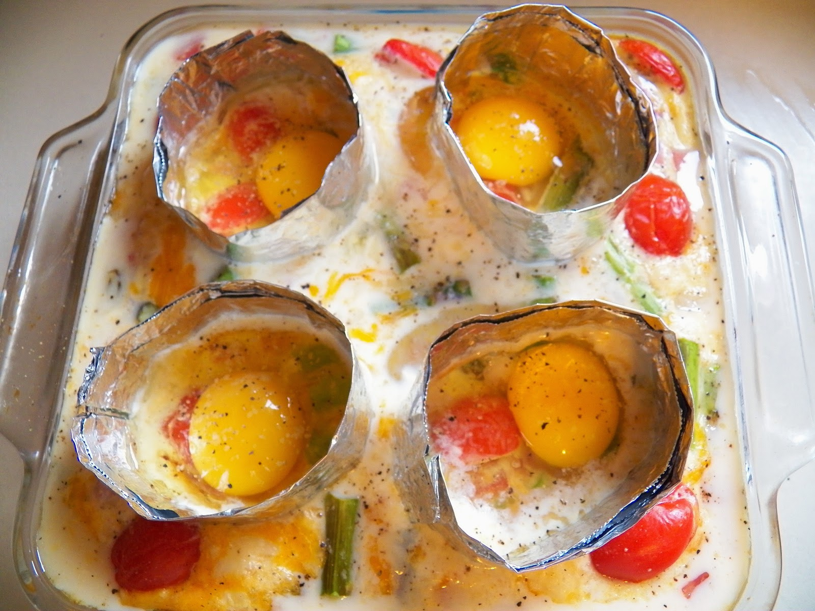 Egg Ham and Asparagus Breakfast Bake with aluminum foil rings