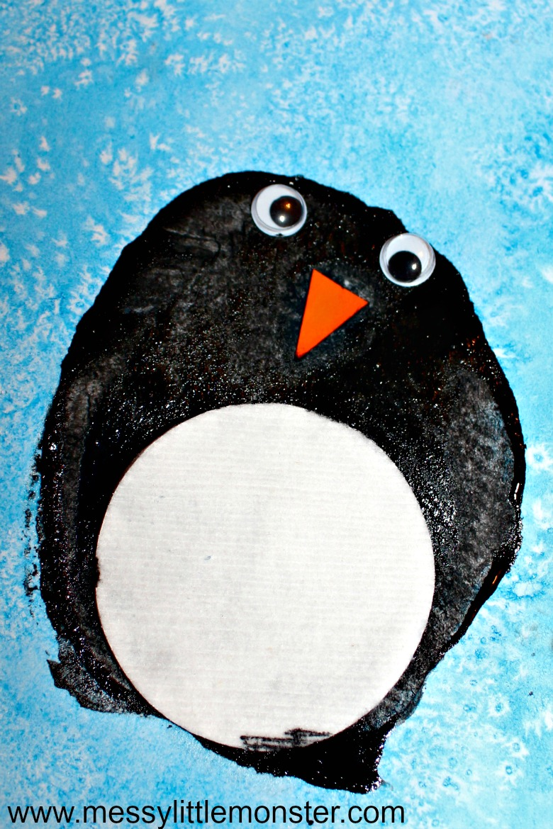 Easy penguin craft for kids. Potato print penguin art using a fun art process idea for the icy sky that uses liquid watercolour paint and sea salt. A quick and exciting winter or antarctic themed project activity for toddlers, preschoolers and older kids.  Also works well if making a DIY penguin fact book.