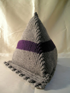large knitted pyramid for tablets with purple stripe
