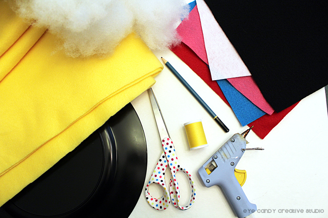 supplies needed to make emoji pillows, felt, stuffing, glue gun
