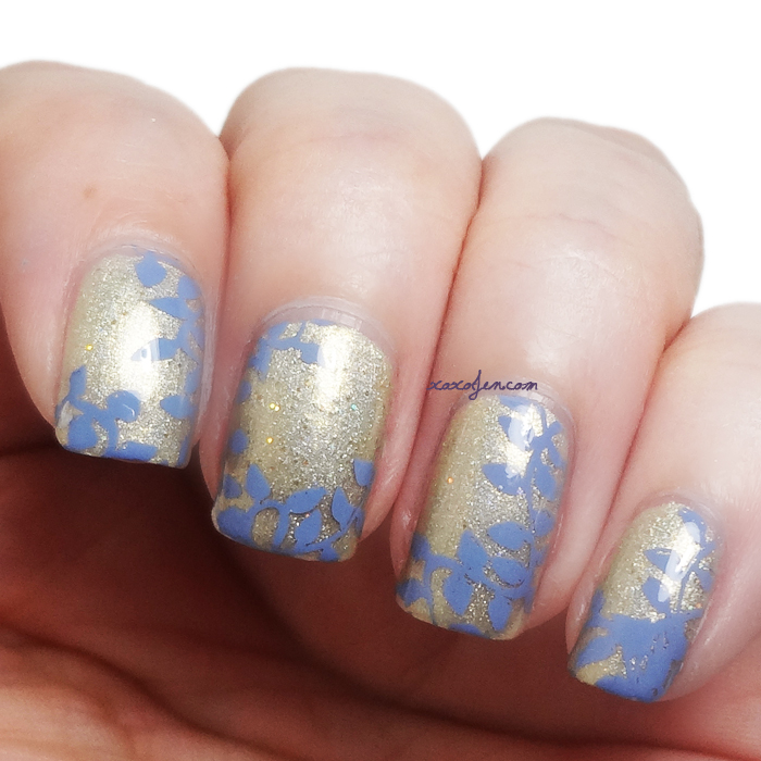 xoxoJen's swatch of Vivid Lacquer: Plate VL007 Stamping