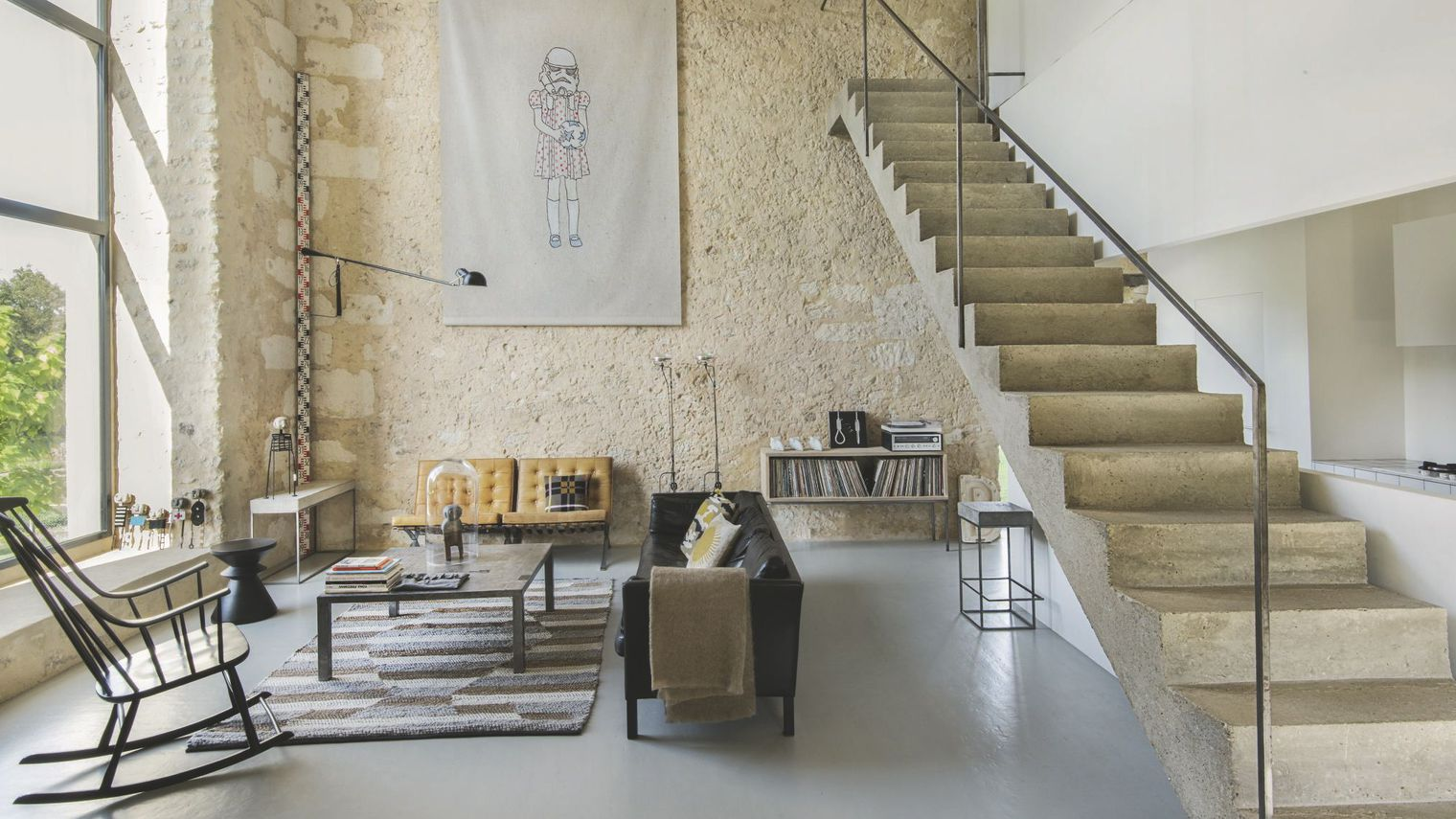 ... A Charming Family Home With Waxed Concrete Floor, Exposed Stone Walls,  Beautiful Furniture And A Mixture Of Both Industrial Style And Contemporary  Look.