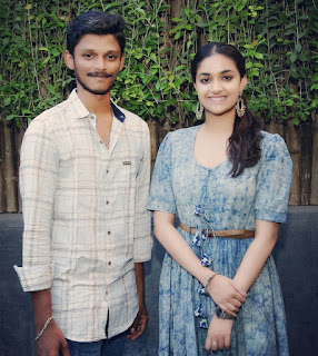 Keerthy Suresh in Blue Dress with Cute and Lovely Smile with a Fan 1