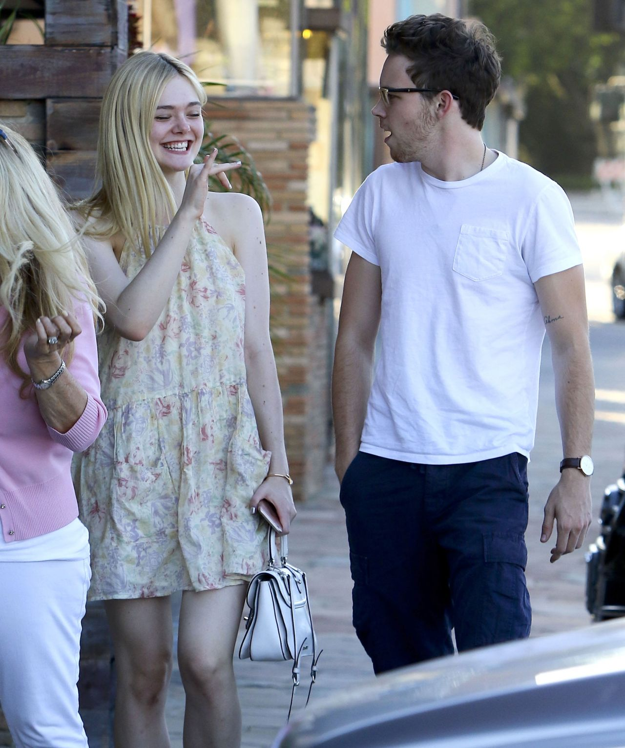 Elle Fanning flaunts legs in a floral dress in Studio City