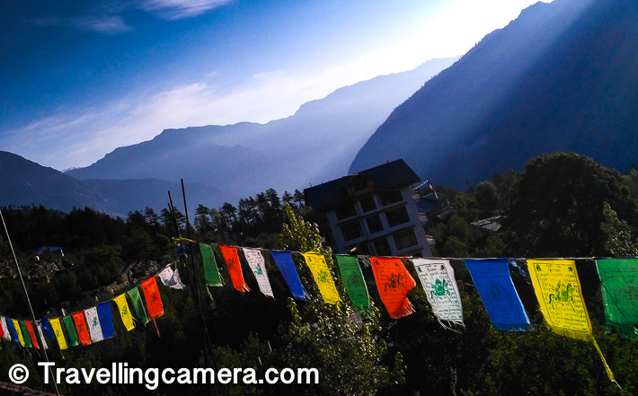 Kalpa village is facing snow capped mountains and snow is there throughout the year. We were there in the month of May and snow was shining bright with thick layers on Kinner Kailash range of mountains. Because of that weather is pretty good here during the day with bright/clear sunlight & air with cool nip in it. The place is also decorated with these prayer flags around the hills in Kalpa. They certainly look more beautiful with the colourful background of snow covered hills & apple orchards.