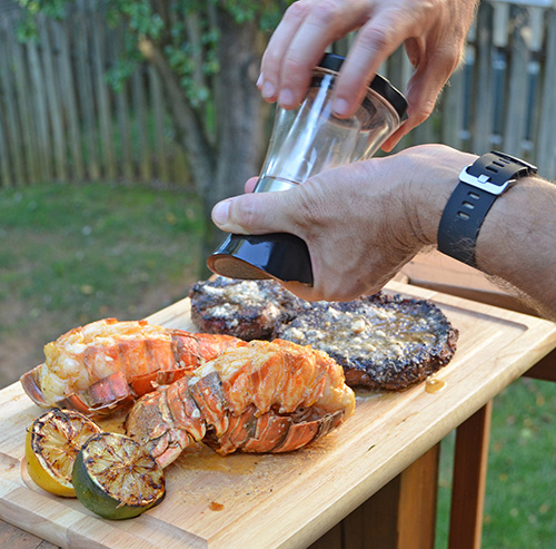 Seasoning lobster tail with Dizzy Pig IPA seasoning finely ground