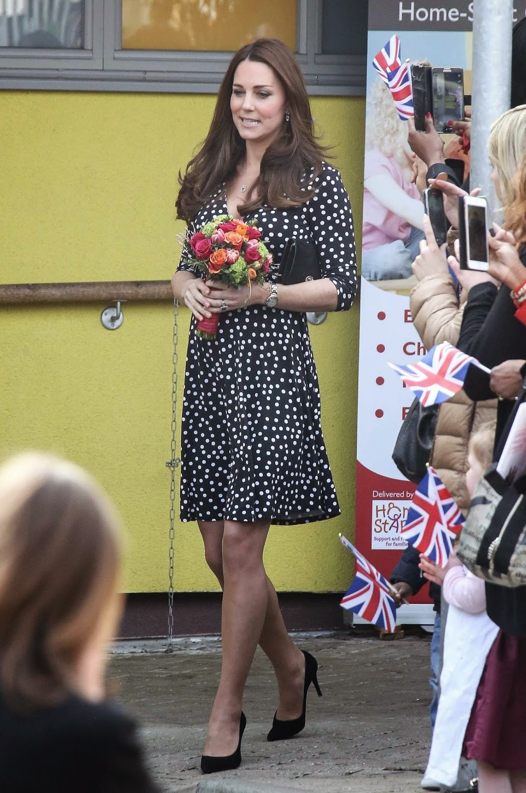 Kate Middleton wears a polka-dotted ASOS maternity dress to Brookhill Children's Centre London
