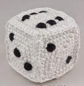 http://translate.google.es/translate?hl=es&sl=en&u=http://ildikko-crochet.com/free-patterns/dice-crochet-pattern/&prev=search