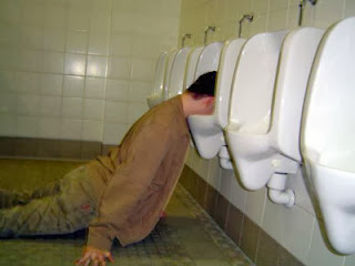 A man passed out in a urinal