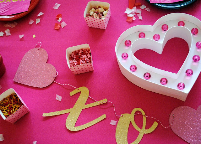 Galentine's Day Cookie Decorating table decor. More inspiration found at www.fizzyparty.com