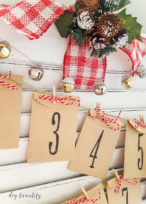 An old shutter is perfect for repurposing as a Christmas advent! I share the tutorial at diy beautify!