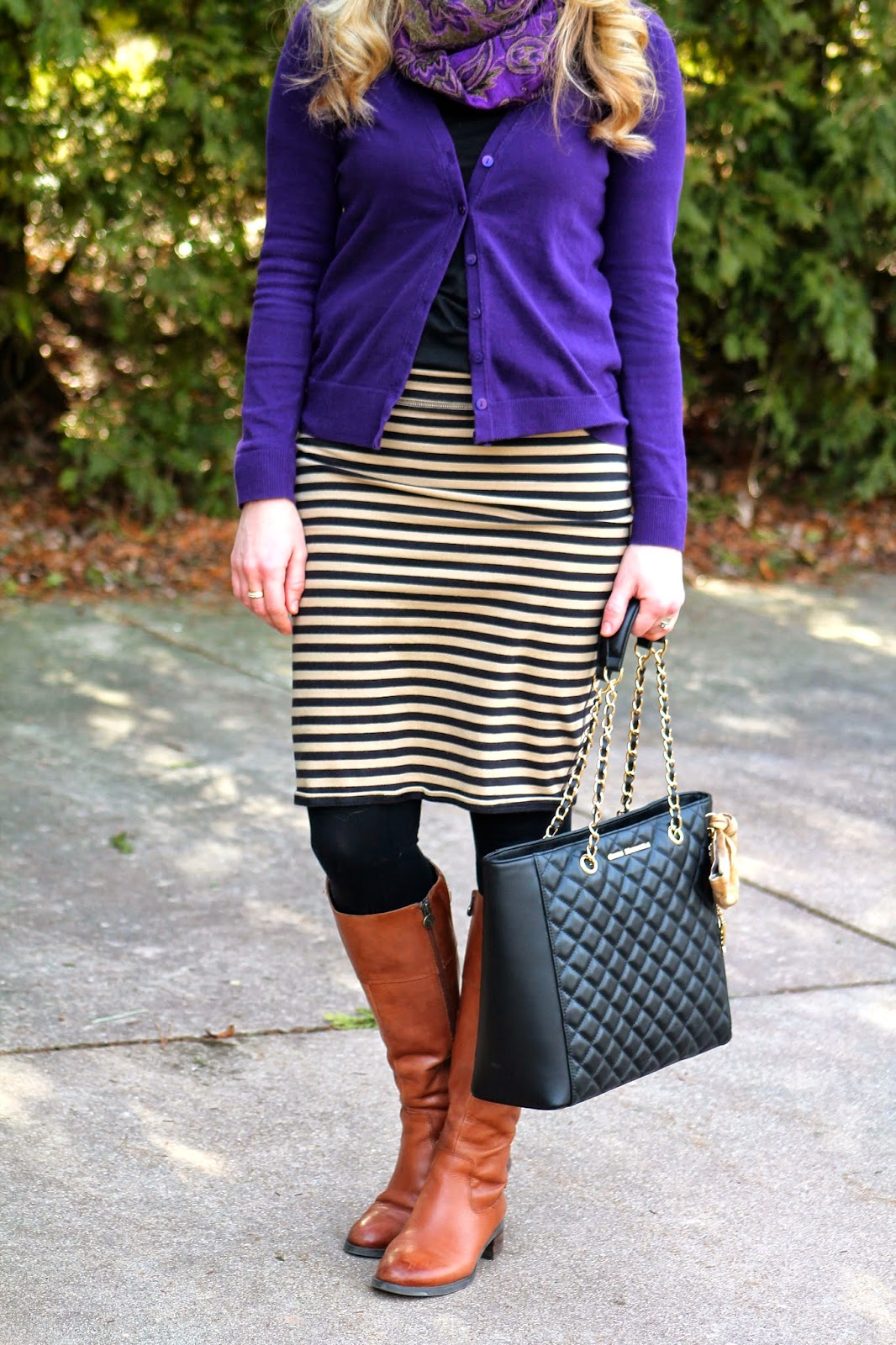 purple cardigan, black camel striped skirt, cognac riding boots, quilted black bag, purple scarf