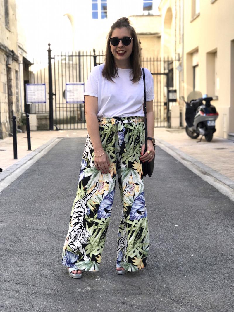 t-shirt blanc et pantalon large imprimé tropical stradivarius, sandales & other stories, trio bag céline et lunette de soleil Asos