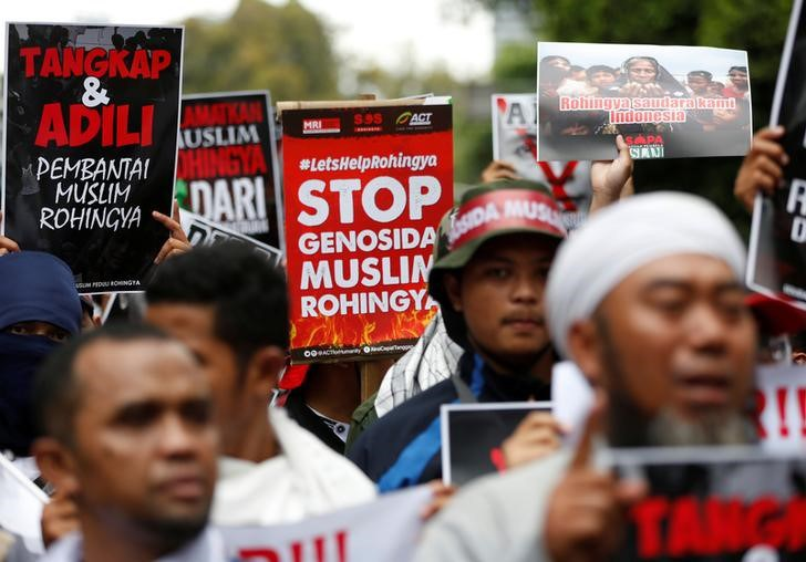 Protesters Hold Signs During A Demonstration Against What Organisers Say Is The Crackdown On Ethnic Rohingya Muslims In Myanmar Outside The Myanmar Embassy