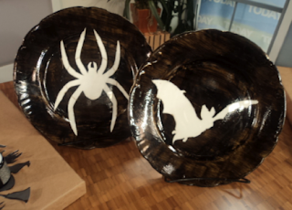 Upcycle an old plate by painting a new Halloween design on it