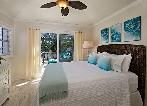 Tropical Ocean Blue Bedroom with Dark Rattan Bed