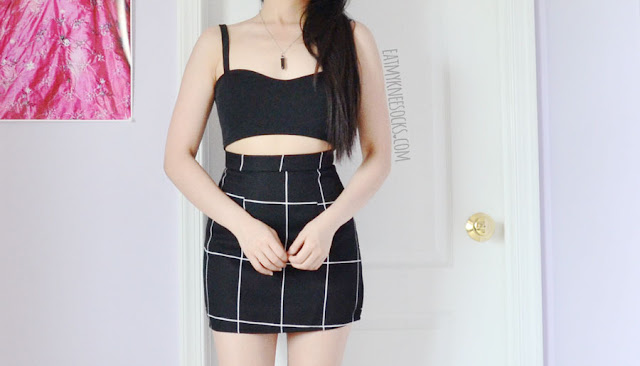 Minimalist monochrome outfit featuring the black caged cutout bralette crop top from Dresslink, paired with a grid print bodycon skirt.