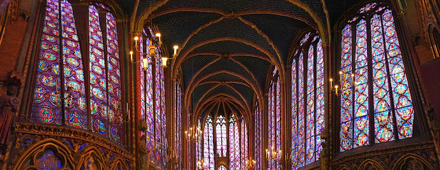 Stained glass windows inside of Sainte Chapelle