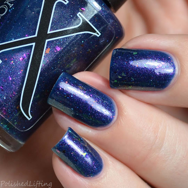 blue nail polish with shifting shimmer and flakies
