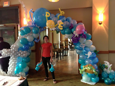 Under the sea themed octopus balloon arch with anchor balloon sculpture