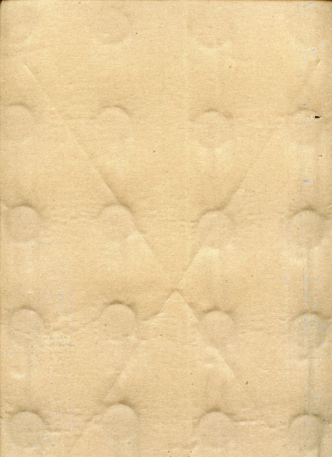 A piece of cardboard with impressed round dents, probably from glasses or bottles.