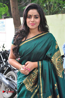 Actress Poorna Latest Pictures in Green Saree at SR Fashion Studio Launch  0004.jpg