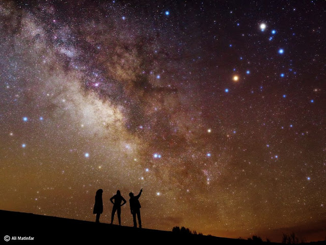 Ali Matinfar captured this image of stargazers under the Milky Way from the Mesr Desert in Iran.   Ali Matinfar / Online Photo Gallery