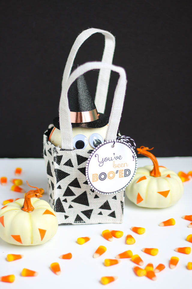 "Surprise your friends this Halloween with these simple ""You've Been Booed"" ideas like this mini pumpkin!"