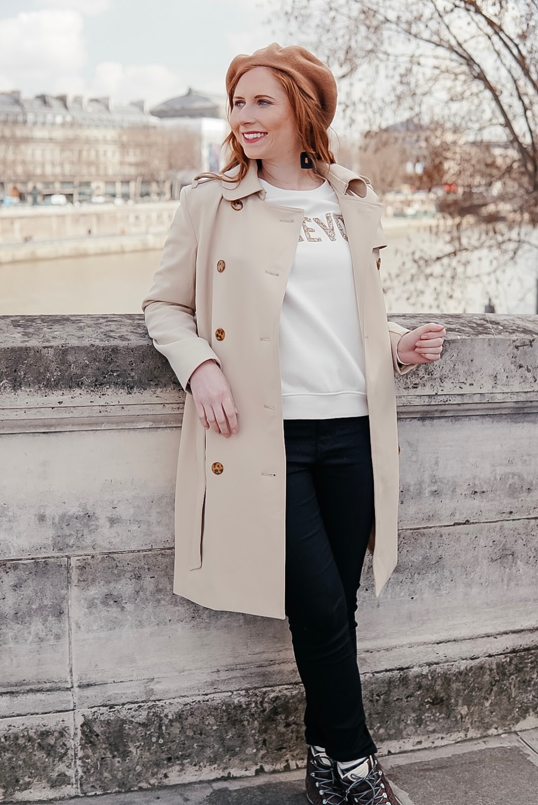 tampa blogger amanda burrows of affordable by amanda wears a tan trench coat in paris, france.