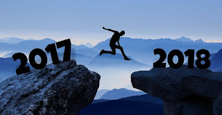 Person jumping between 2017 and 2018
