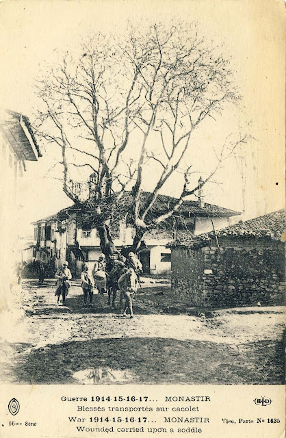 """Transfer wounded in saddle. In the background is seen the oldest tree in the city called """"Chinar"""" (still existing today). The house in the background of this picture is also still existing with small changes in the windows."""