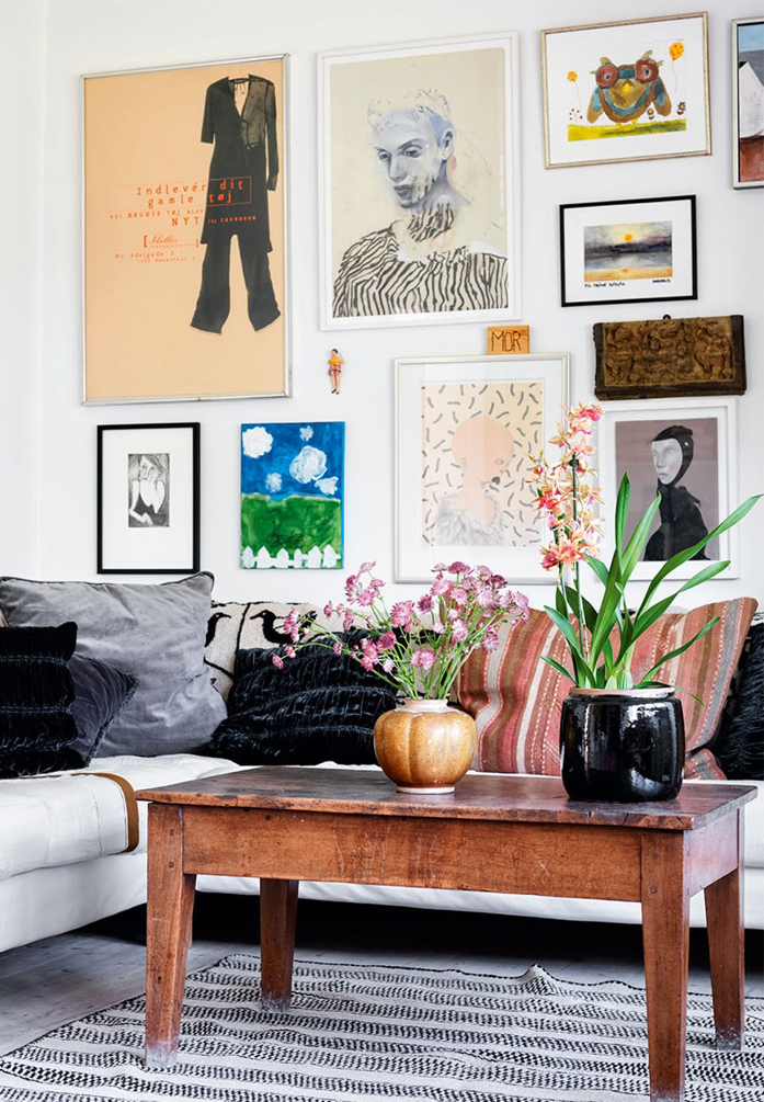 Loving the mix of this gallery wall and a simple vignette of plants on the coffee table- design addict mom