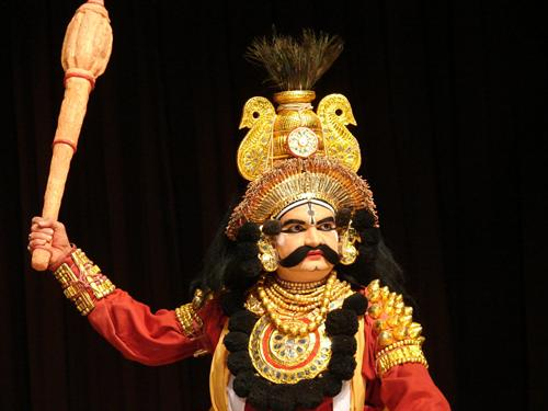 A kings costume (raja vesha) with kireeta (or headgear); the mace is used as an abstract depiction of a weapon