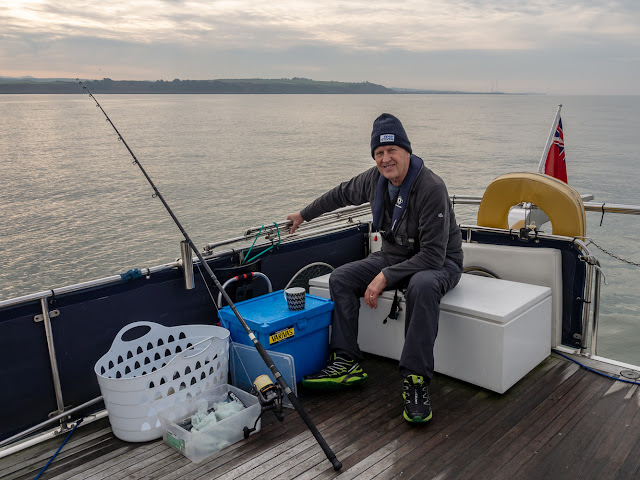 Photo of Phil waiting for a fish to bite